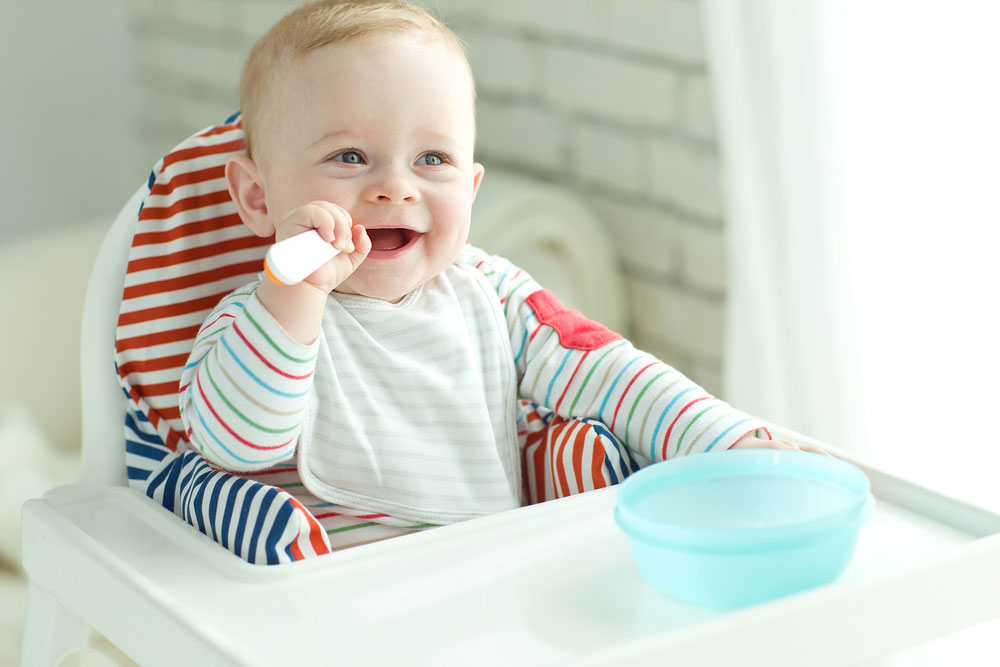Babies using spoons safely
