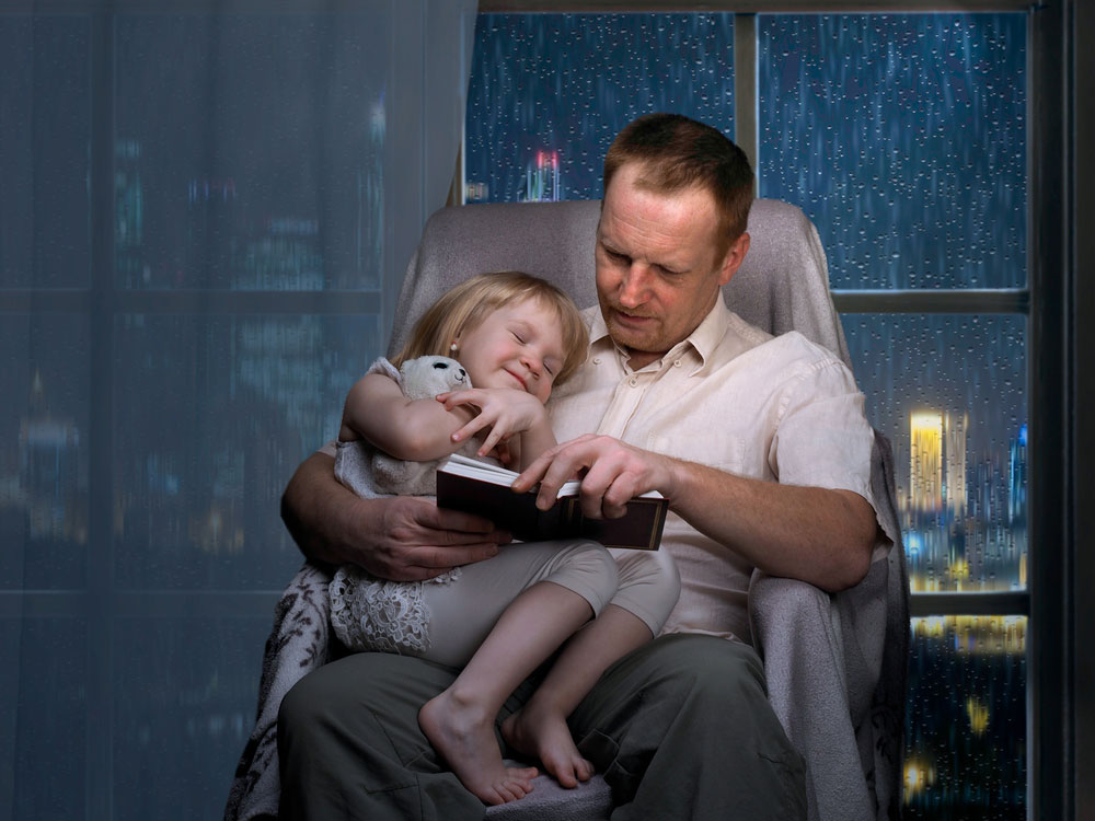 Father coaxing daughter to sleep