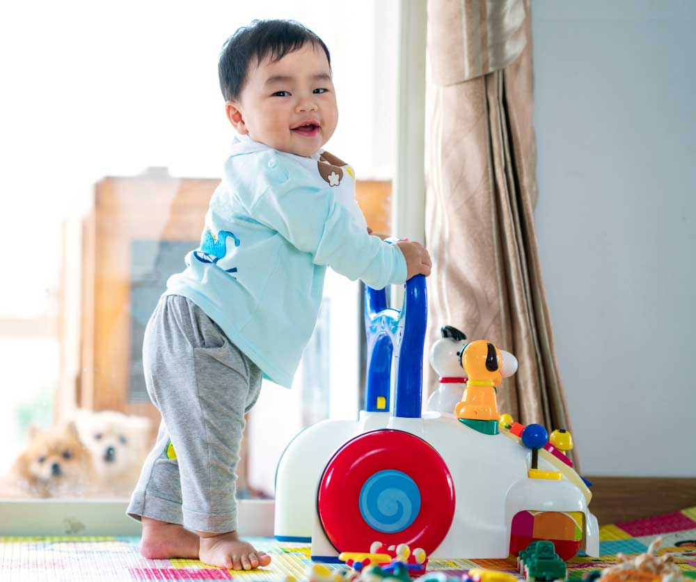 baby playing with a walker