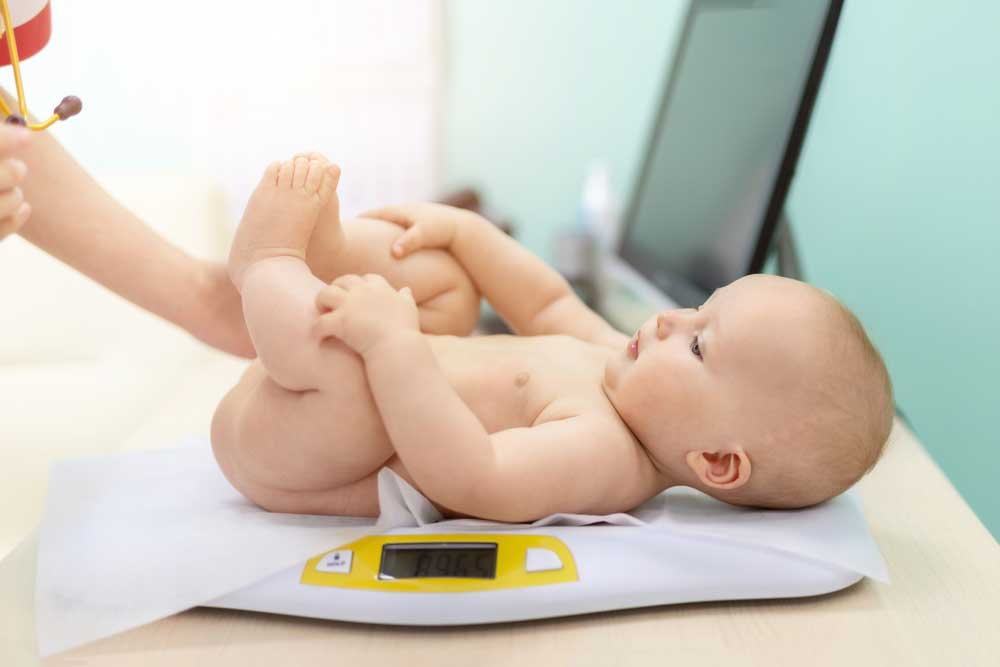 Baby on a yellow scale