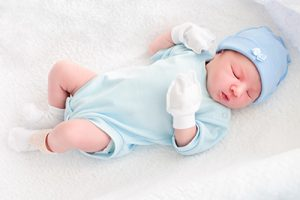 a baby in gloves
