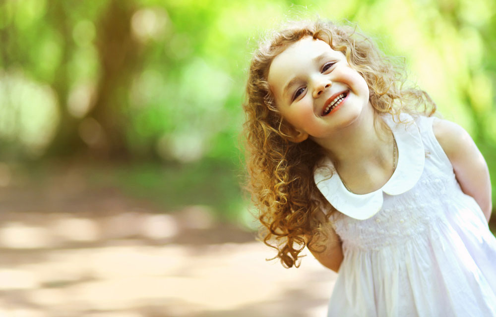 Smiling Girl With Curly Hair