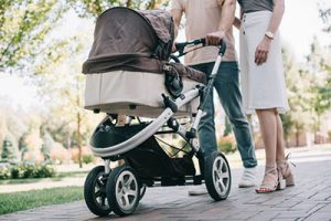 Dad and mum walking baby in a stroller