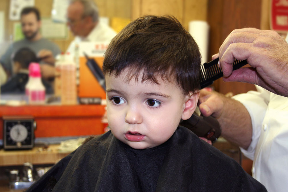 A baby getting a haircut