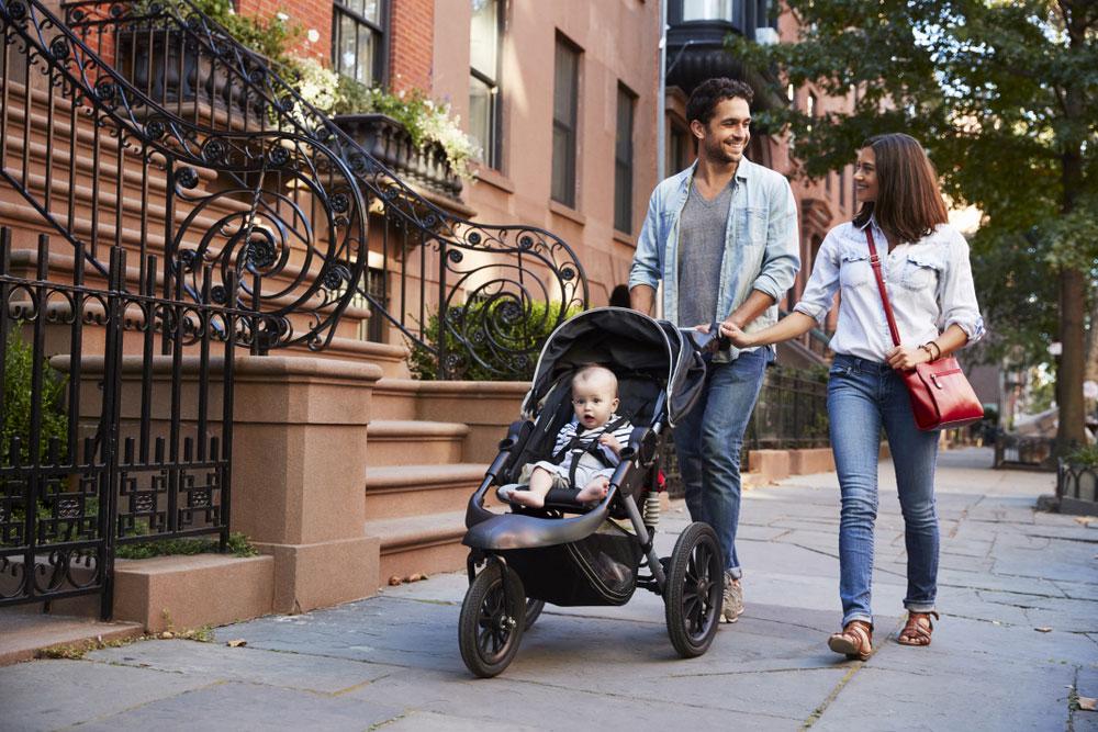 Family Pushing Baby on Stroller